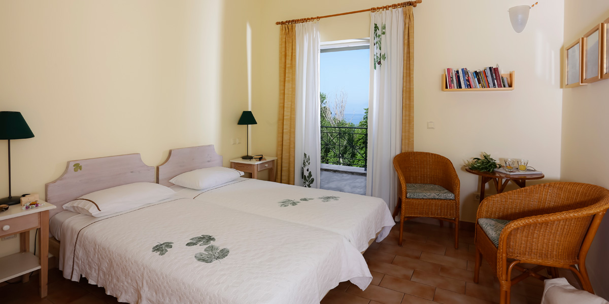 Chambre pour deux personnes avec 2 lits à une place